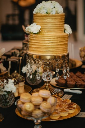 Gold wedding cake with sweets