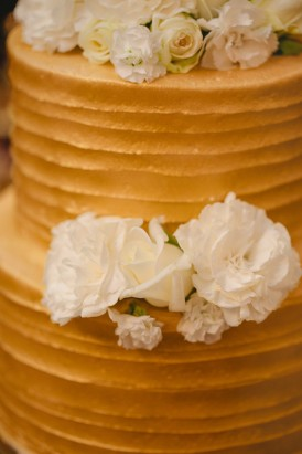 Gold wedding cake with white flowers