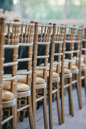 Golden chivari chairs at wedding