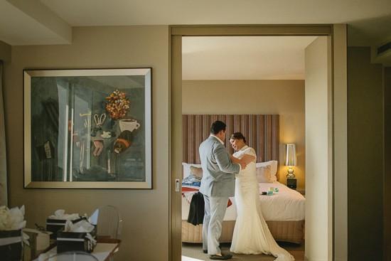 Groom helkping bride get ready