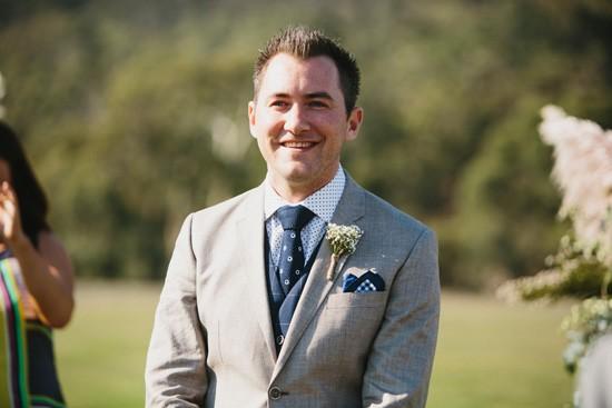 Groom in grey suit with navy tie