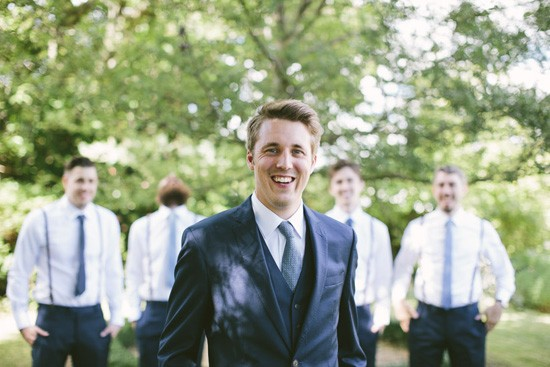 Groom in navy three piece suit