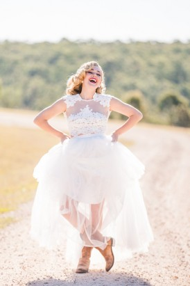 Laughing bride with tulle wedding dress and boots