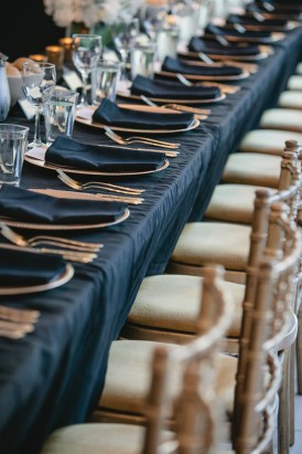 Long tables at weddin with black linen