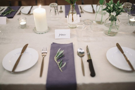 Navy napkin at wedding with olive leaf