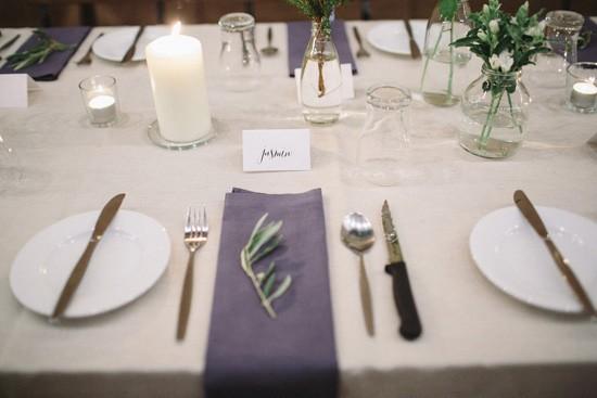Navy napkin at wedding with olive leaf