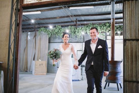 Newlyweds entering country wedding