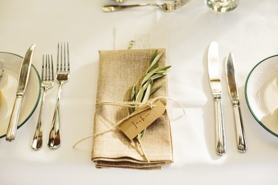 Olive branch on napkin at wedding
