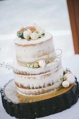 Semi naked wedding cake with cream flowers