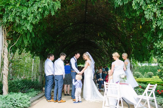 Wedding under wisteria arch