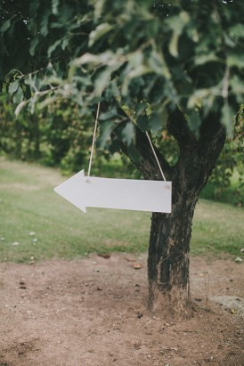 White arrow direction at wedding