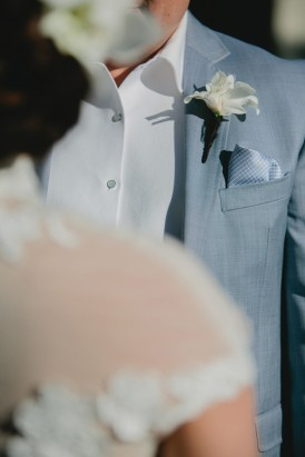 White boutonerrie on grey suit