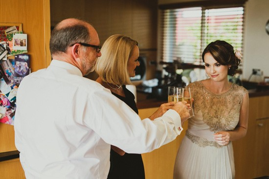 Bride-toasting-champagne-with-parents