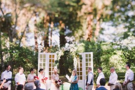 Wedding ceremony in front of french doors