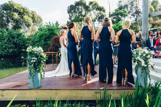 Wedding on a deck with bridesmaids