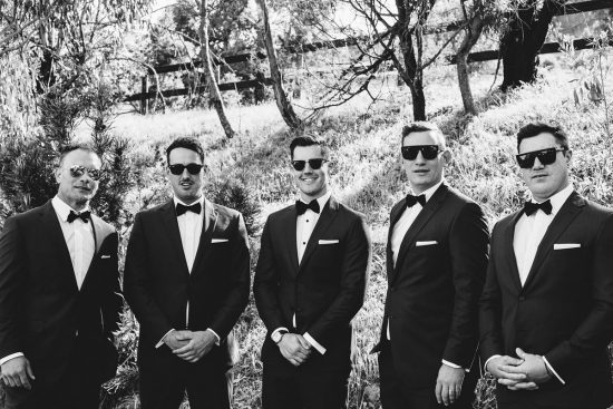groomsmen in black bowties