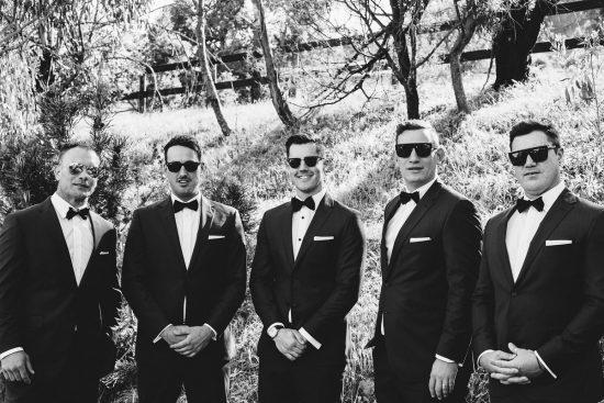 groomsmen in black bowties