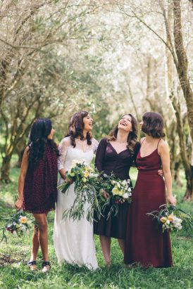 Bride with bridesmaids in marsala
