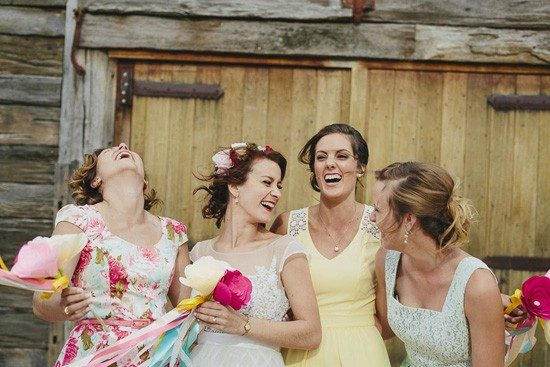 bride-with-bridesmaids-in-yelllow-and-mint-550x367