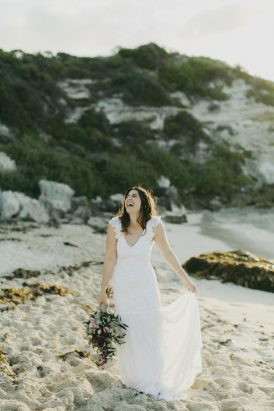 bride-laughing-on-beach