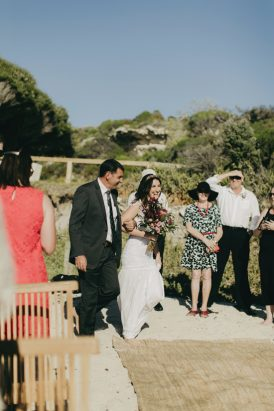 bride-walking-down-the-aisle-at-beach