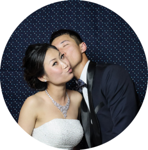 Bride and Groom in Photo Booth with Navy Backdrop