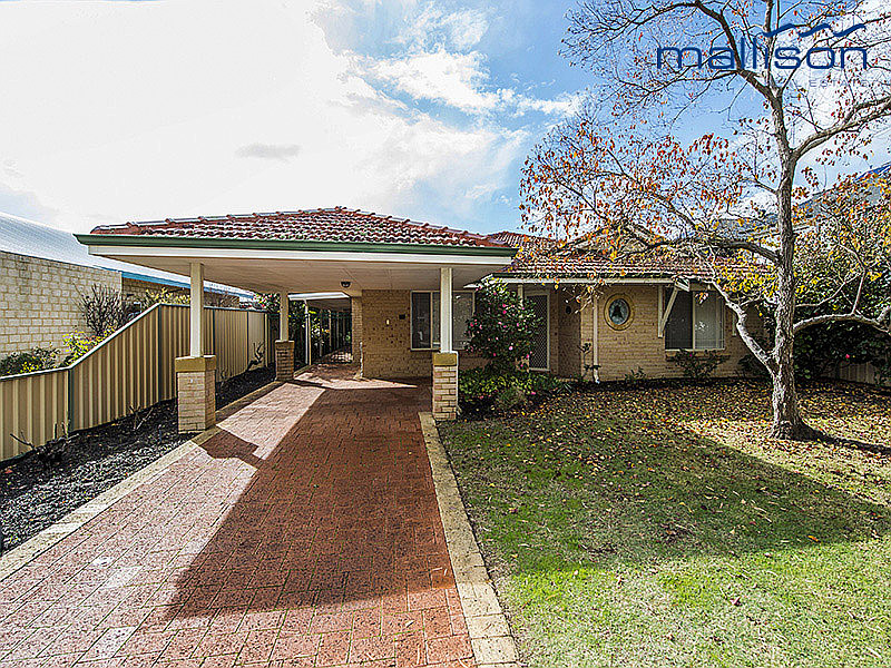 SPACIOUS, IMMACULATE HOME LOCATED IN QUIET STREET