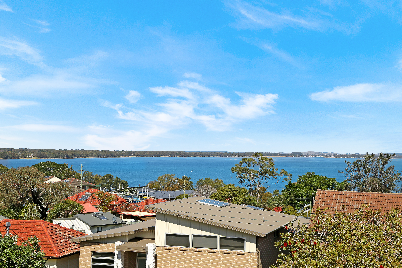 Boasting Potential, Location & Breathtaking Water Views!