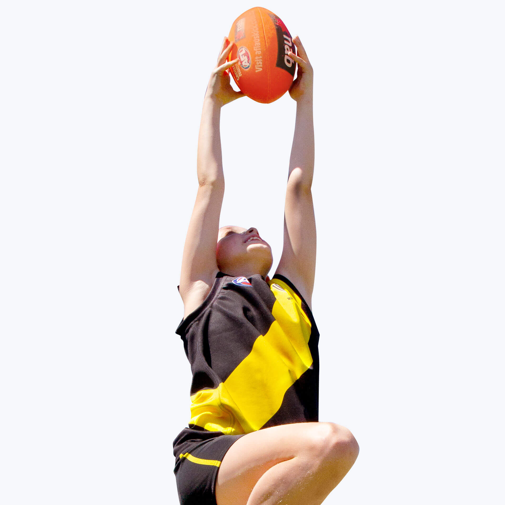 A girl leaping to catch a ball