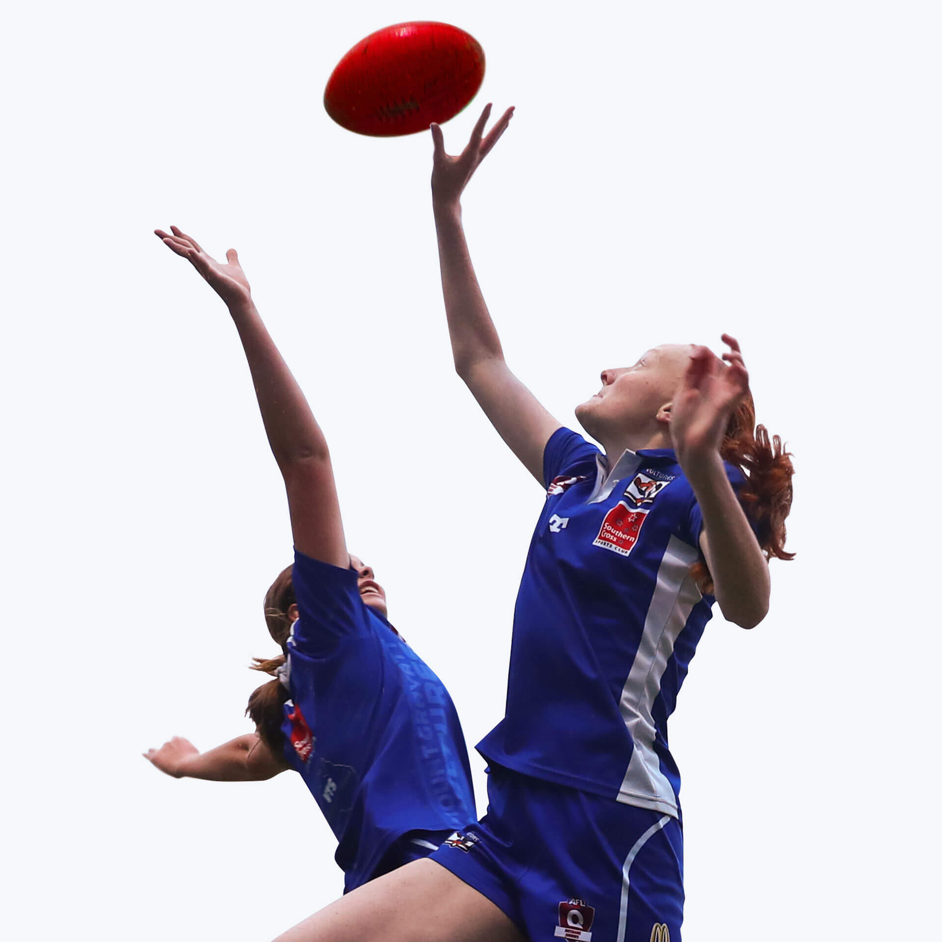 2 young women jumping for a footy ball