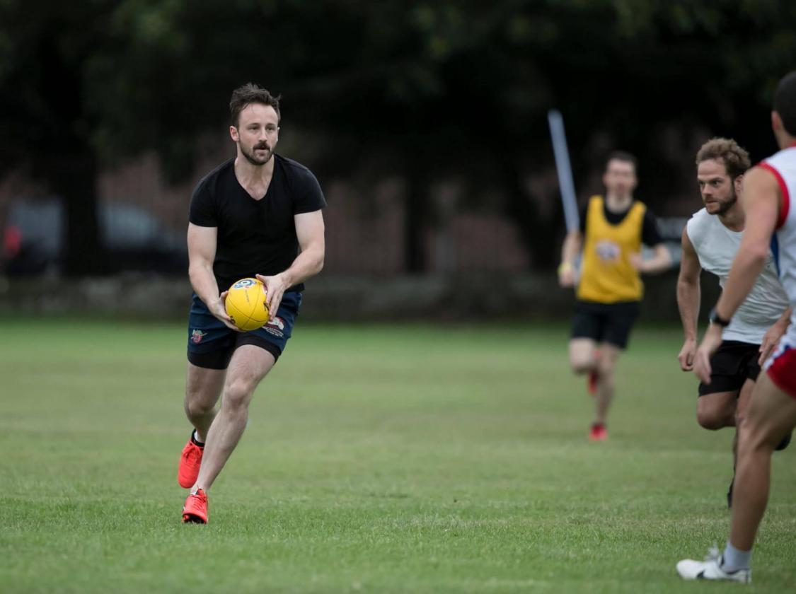 A man running with a ball