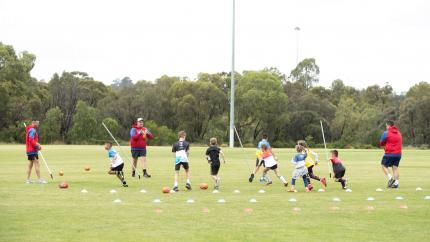 Kids doing auskick training activities