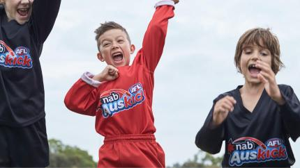 A young boy cheering!