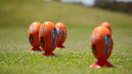 Footy balls sitting on plastic cones