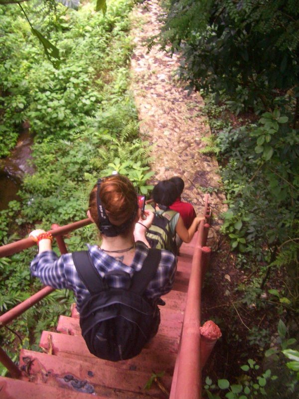 Our team, Shelley, Grace and Fi, traversing stairs linking some of the Vieng Xai Caves