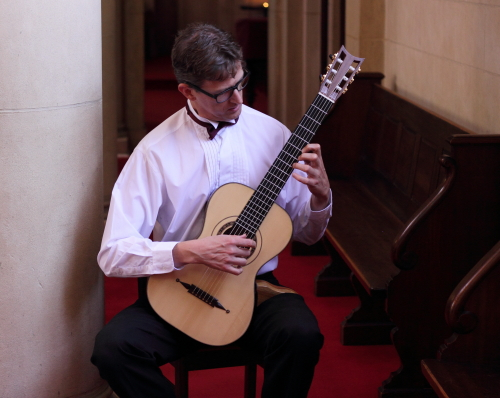 Bruce Paine with his Louis Panormo guitar replica