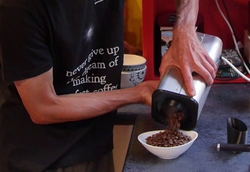 Pouring out freshly roasted coffee