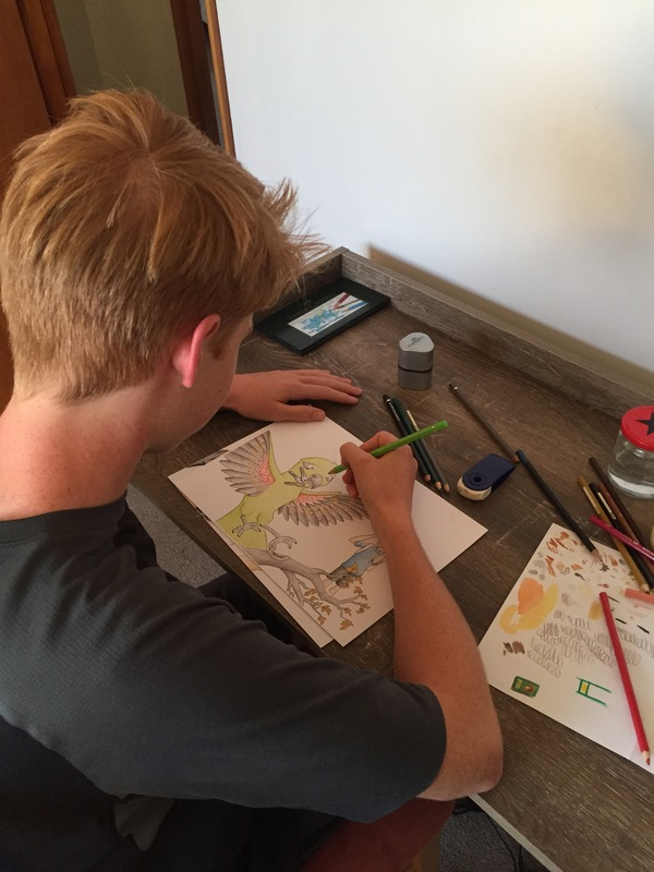 Bailey working on his illustrations.