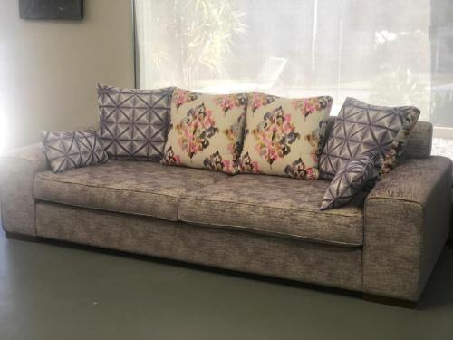 2 seater lounge with 4 back box cushions