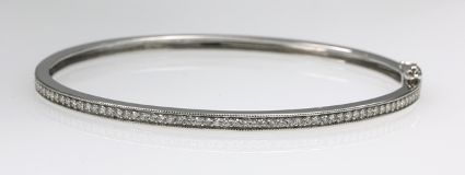 18ct W/G Diamond set hinged bangle
