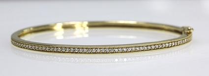 18ct Y/G Diamond set hinged bangle