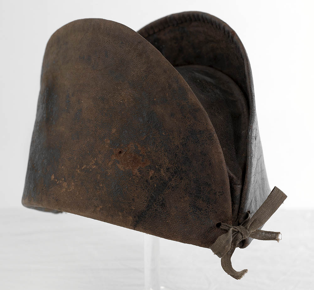 Old cap that has a bow tied at the front known as a convict cap pre 1849