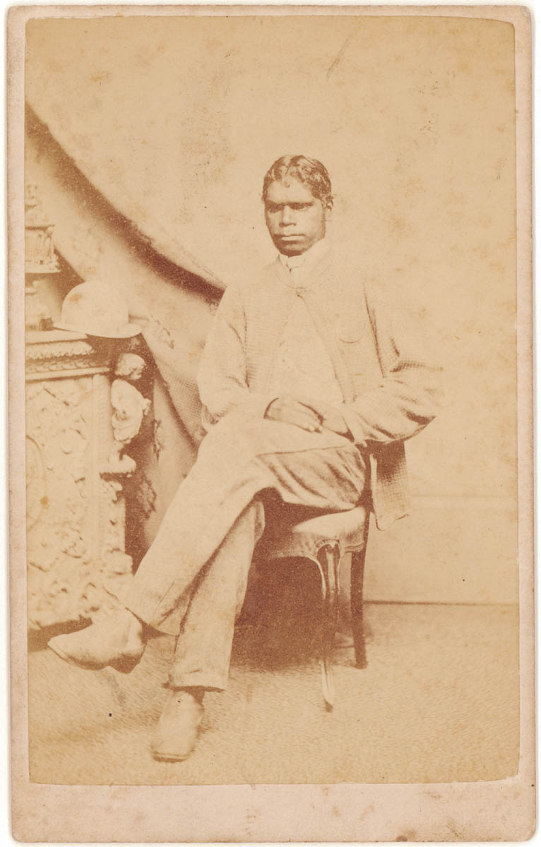 Portrait of an Indigenous Australian seated in clothing of the era 1867