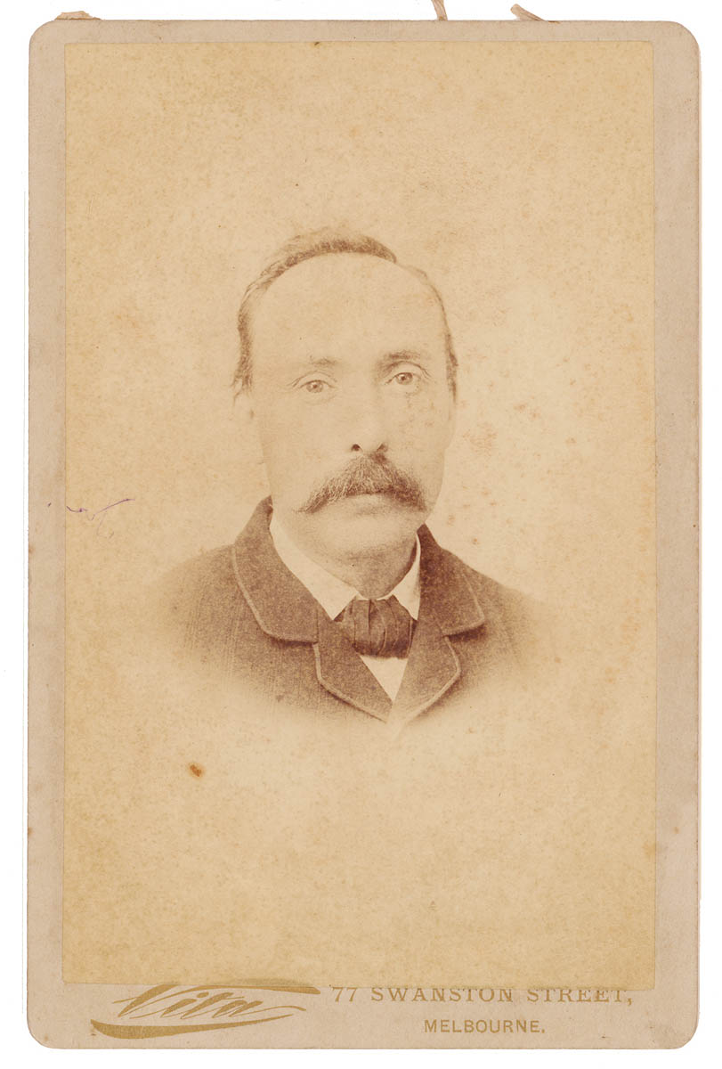 Old portrait of man with a moustache wearing a jacket