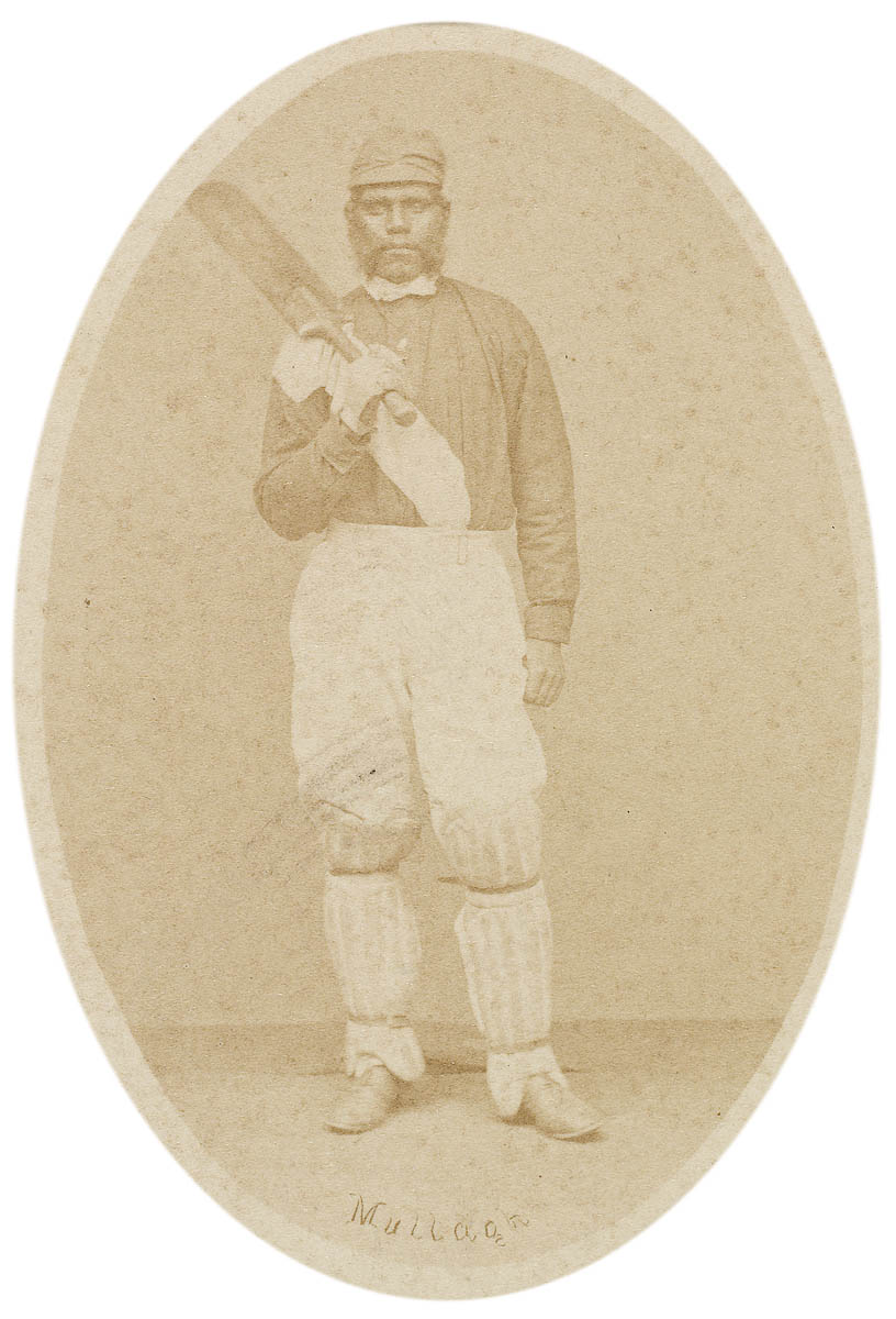 Old portrait of an Indigenous Australian cricketer in the uniform of the day with cricket bat in their hands