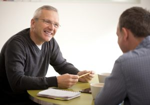 A mature-age candidate interviews for a job