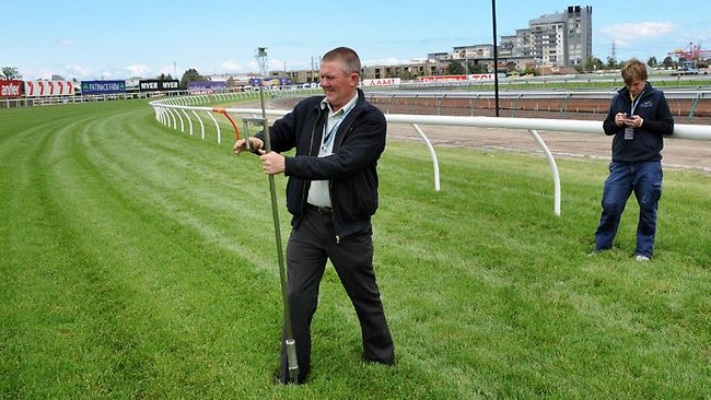 Flemington Track Manager, Mick Goodie, using a penetrometer