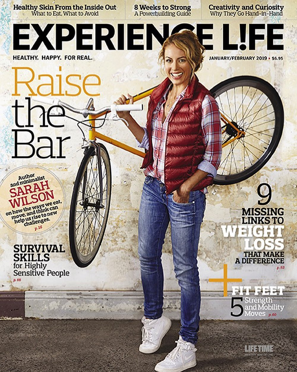 Sarah and her bike featured on the front cover of Experience Life magazine - Jan/Feb 2019 edition