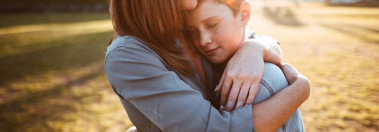 teenager embraced with mum