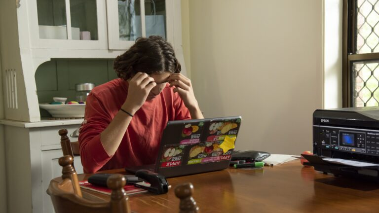 Teen looking stressed at computer